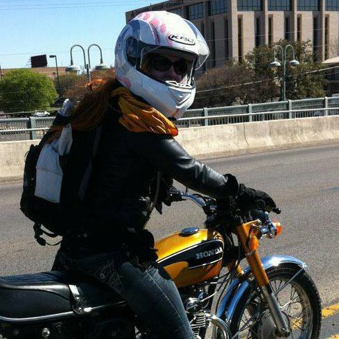 Motorcycle babe On a classic Honda CB175