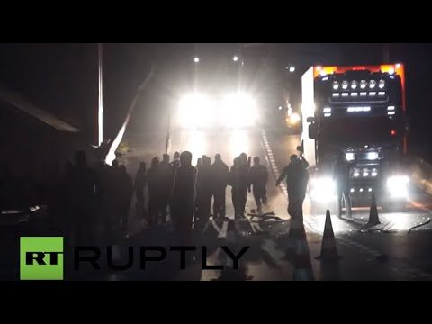 France: Police fire teargas as refugees block trucks over camp eviction