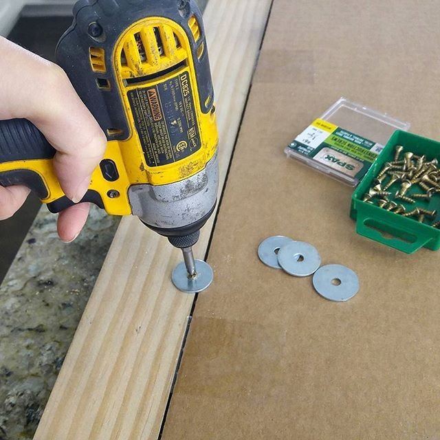 """Quick tip for DIY picture frames. Attach a fender washer on the backside to hold everything tight in place.  Search """"picture frame"""" on the blog to learn how to make any size frame, complete with glass."""