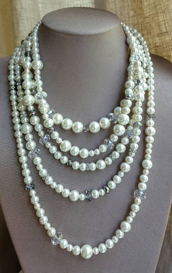 Check out this item in my Etsy shop https://www.etsy.com/ca/listing/459482250/multistrand-pearl-and-crystal-statement