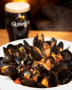 A serving of fresh #NovaScotia mussels and a Guinness at Durty Nelly's in #Halifax.