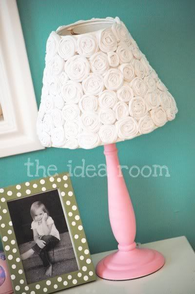DIY lamp shade redo using a thrift-store shade and flowers made from an old t-shirt. Cute for a little girl's room or shabby chic decor. #tutorial