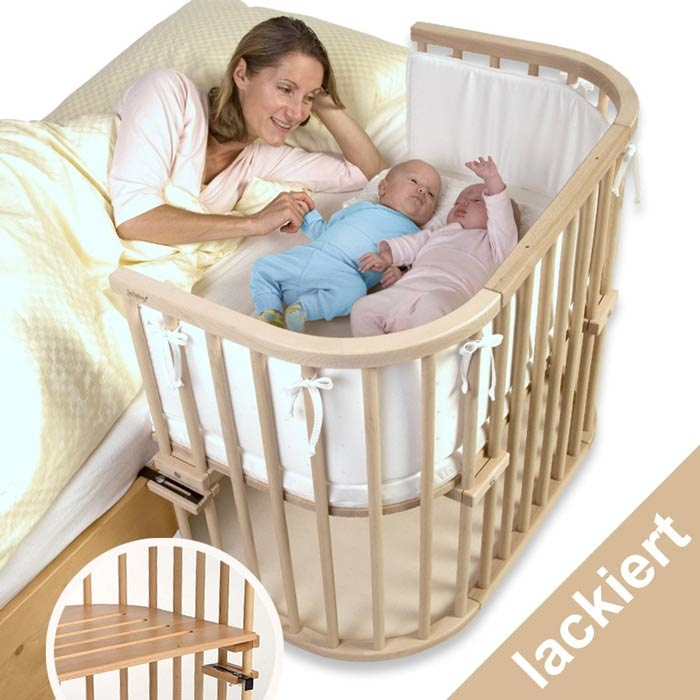 Babybay Maxi. Bedside crib. It is rather small, baby outgrows it fast; maybe for one baby till 6 months with indulgence. used in maternity wards in Germany - can easily be moved on wheels and has a safe lock on side when not connected to bed. costs a lot of money to be used for a few months only. Twins? no way. I used the Stokke Sleepy in medium size for both till almost 1 yo. Then bought a second one.