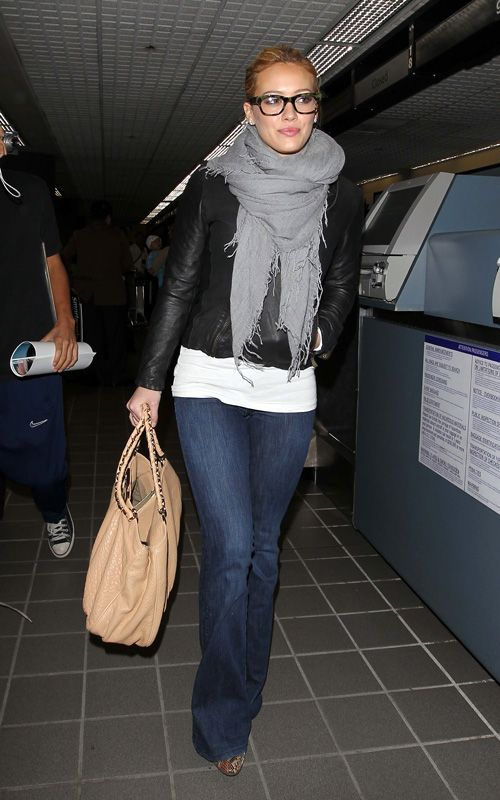 Airport style. Love the glasses. Must. Get.