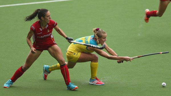 Stephanie Kershaw of Australia (R) passes the ball away from Judith Vandermeiran of Belgium (R) during the Fintro Hockey World League 5/8 place playoff game between Belgium and Australia on July 1, 2017 in Brussels, Belgium.