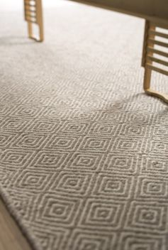 Classic Diamond taupe and natural cream. Flat weave Rug looks great.
