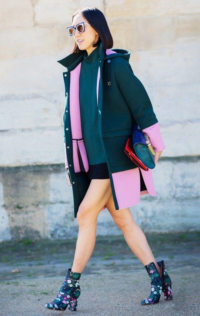 Eva Chen wears a minidress, colorblock coat, flap bag, Fendi cat-eye sunglasses, and floral Valentino boots