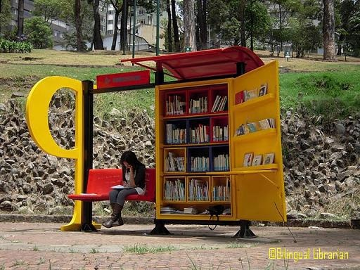 Not exactly a little free library..not almost - a mobile library at a bus stop in Colombia