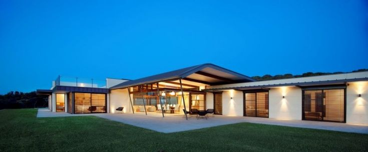 Stunning View From A Modern Minimalist House:nightfall-facade-with-large-green-grass-view