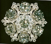 King William IV (Adeleide's) Brooch. 1830 the King William IV took 6 lg brilliants & a number of smaller stones from his father's Badge of the Order of the Bath had this brooch made. It was left to the Crown by Queen Victoria in 1901. Queen Mary attached a large oval diamond drop to the brooch in 1929 and Queen Elizabeth wore it (without the drop) at her Coronation. 'The Jewels of Queen Elizabeth II' by Leslie Field p/b p 80.