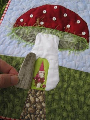 This would be a cute idea, on the back of a quilt with a little house, to put the quilted by tag in, then maybe a small snap to keep it closed.  Peek a boo door - gotta do this!