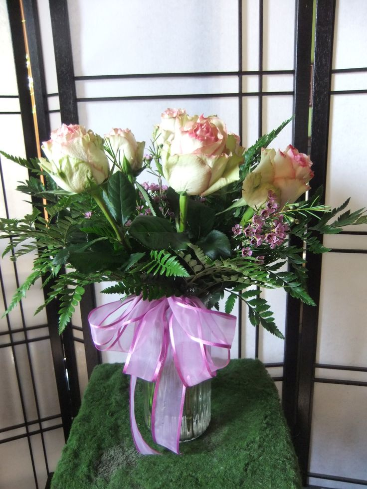 Ladies Choice ,half dozen pink esperance roses with pink waxflower & leather in a glass vase