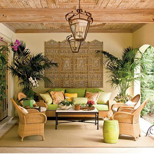 Add wicker furniture and palms to a backyard space for a Spanish oasis feel with nice Mexican patterned cushions and pillows.