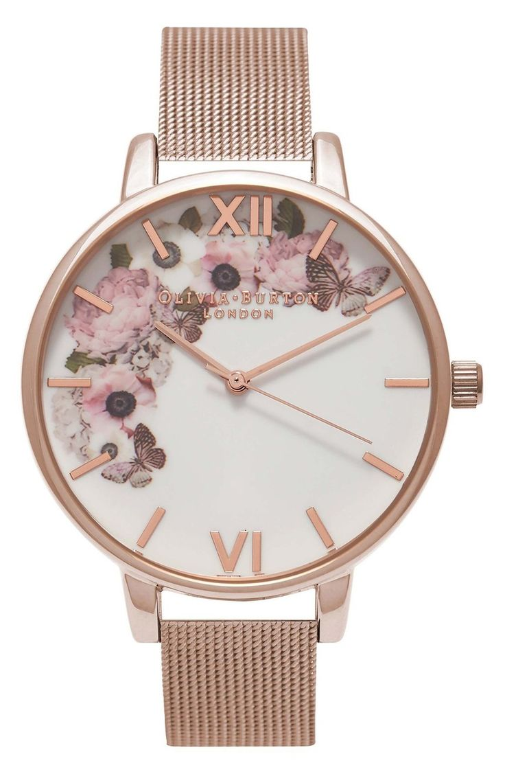Butterflies flutter about baby pink roses on the dial of this ultra-cute watch, exemplifying Olivia Burton's nature-inspired whimsy and charm.