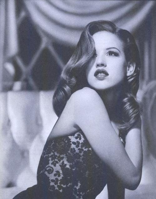 Molly Ringwald pictured in 1985, looks like a real-life Jessica Rabbit.