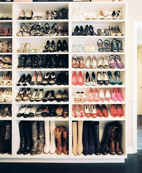 Traditional Closet: Shoe storage on white built-in shelves.