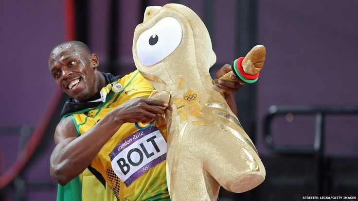 Leaving the best until last - Usain Bolt of Jamaica celebrates his win in Sunday's 100m final by holding Wenlock, one of the official Olympic mascots, in his trademark victory pose