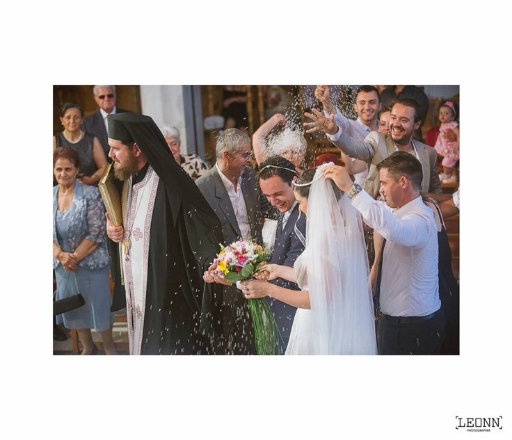 Throwing rice at the bride and the groom, Greek wedding tradition  Photo by Leon