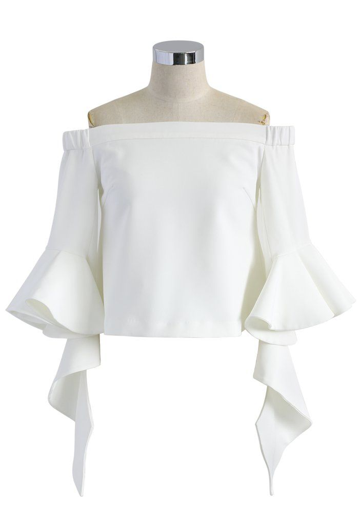 So much for your Plain Jane t-shirts getting all of the shine this spring. Step out with elegance (yet modesty) in this ethereal frilling top. The frills and shoulder cleavage give it the perfect dose of va-va-voom. We're swooning. Are you?