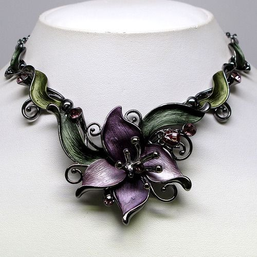 Love this because: unusual/striking; bold, curved lines; floral/botanical theme; color combination green/purple