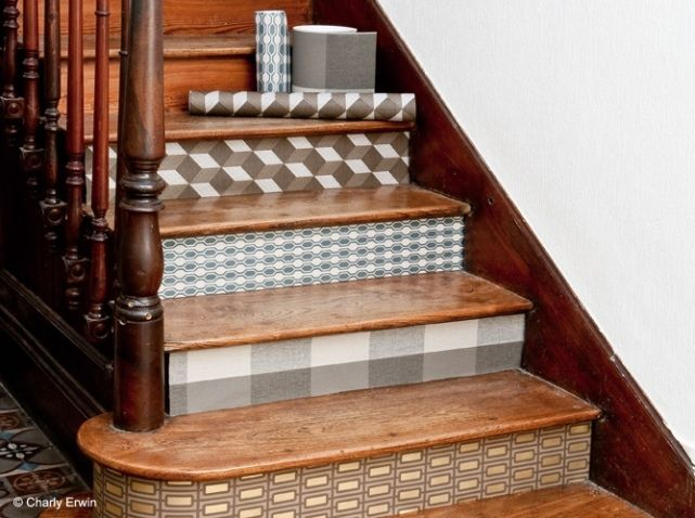 Paper covered stairs. An inexpensive & novel way to upstyle your stair case face plates. You could try out wallpaper rests, quality wrapping paper or Vinyl self sticking deco paper. If your renting you should ask first before sticking anything thats hard to get off though. Double sided tape should work ;)