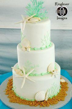 Mint green beach wedding cake.