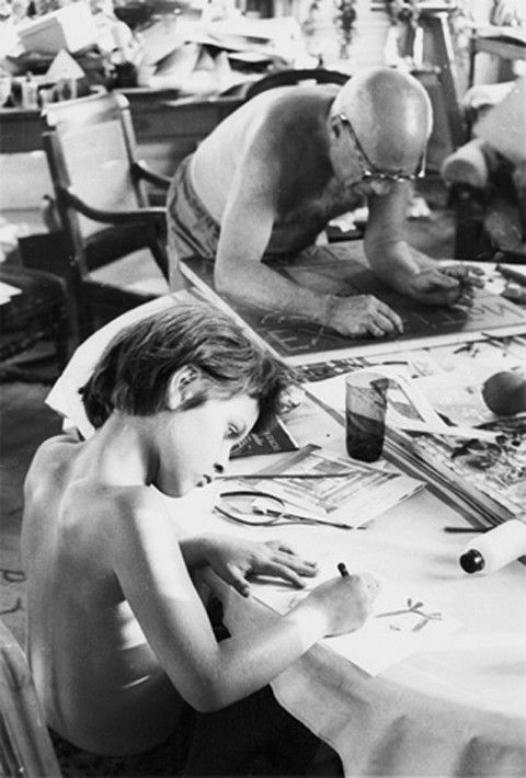 Picasso's daughter, Paloma works on her latest creation while her father works on his, Villa La Californie, 1957. (via Scala Regia)
