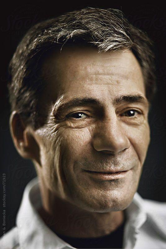 Closeup studio portrait of a handsome middle age man  by Stalman & Boniecka