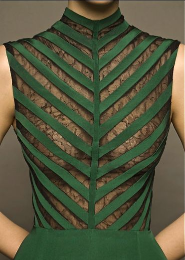 Dina Jsr details...cut out sleeveless green dress with mesh lace backing