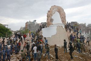 Nepalese rescue workers gather at the collapsed Dharahara Tower in Kathmandu