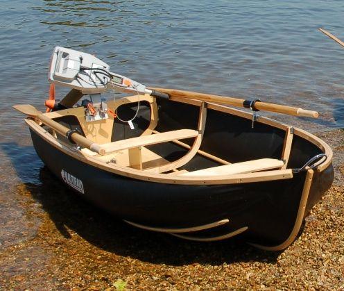 Nesting, Portable, Folding Boats & Dinghies UK - Nestaway Boats Ltd - NAUTIRAID Folding Boats - Above: The prettiest folding boat you can buy? Coracle 250 showing (optional) 7ft oars, chrome rowlocks; Torqeedo 1003 on transom.