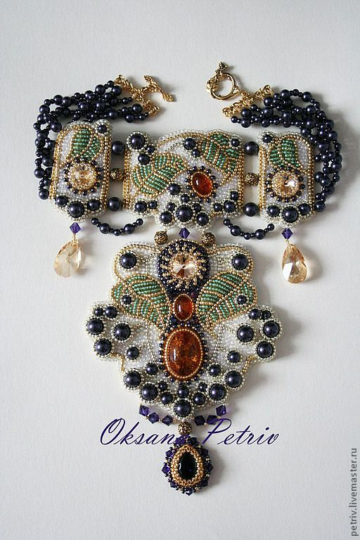 VERY dramatic bead embroidered necklace!! Made by Oksana Petriv made using natural amber, pearls, Swarovski crystals, Japanese seed beads, TierraCast and 22K plated findings.