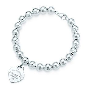 Return to Tiffany™ small heart tag in sterling silver on a bead bracelet.