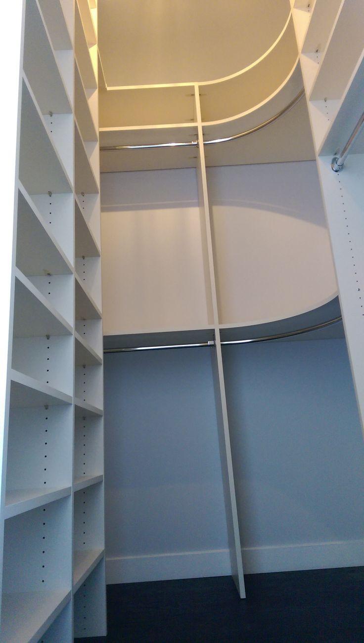 Curved corner of a custom master closet