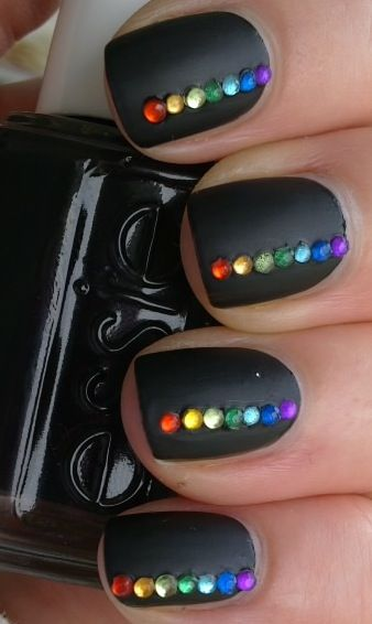 matte black nail with rainbow gem detail