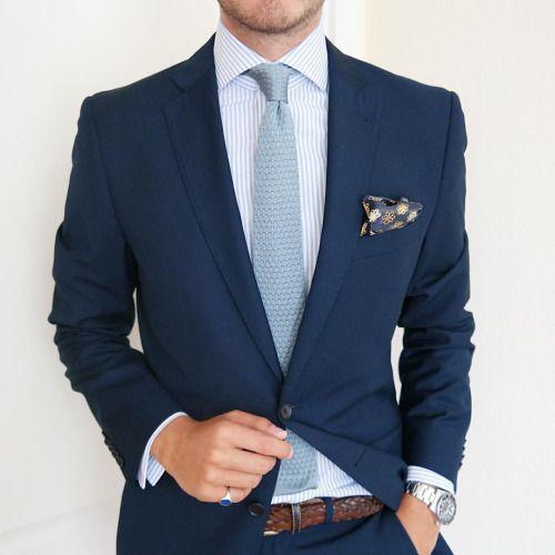 Light blue tie, dark blue suit