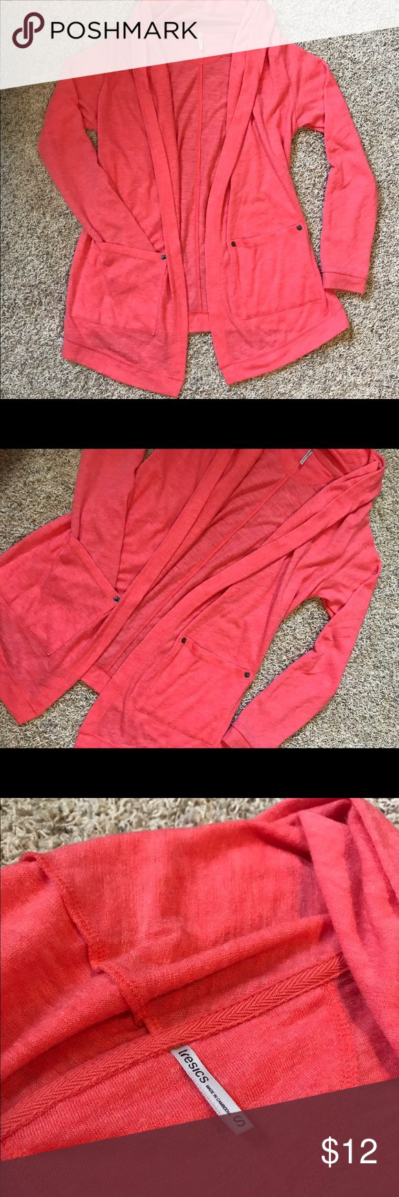 Pink cardigan with pockets - small Very cute and unique pink / coral cardigan from a boutique. Color is true to pictures. The cardigan is SO comfy! I only wore it 1-2 times though because I'm not a huge fan of wearing pink. Excellent condition, From a clean, smoke-free home! tresics Sweaters Cardigans
