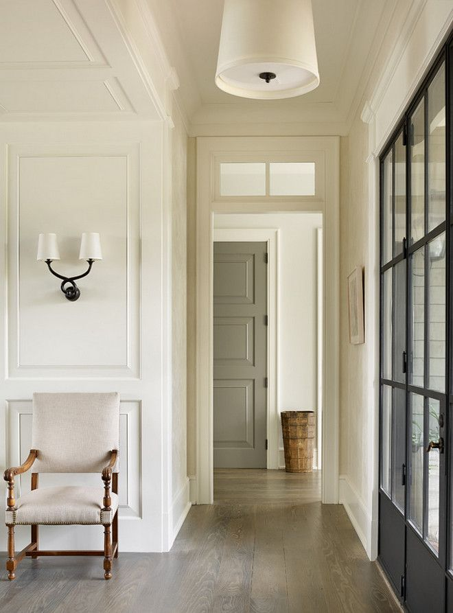"""Paint color for interior doors: dark grey. Benjamin Moore Kendall Charcoal. The floors are 7"""" White Oak Planks with a custom finish. Beth Webb Interiors"""