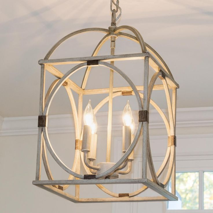 Cool look with light wood finish that would play off of the island. Very different and still pretty Circle Lattice Hanging Lantern