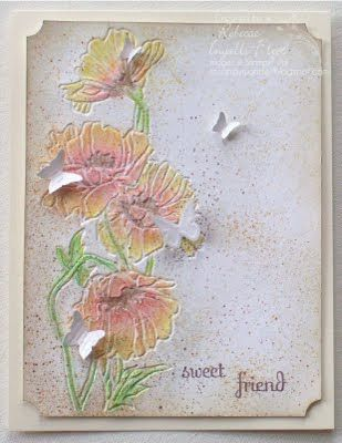 "By Rebecca Ingalls Fleet. Dry emboss a white panel with ""Flower Garden"" folder (Stampin' Up/Sizzix) using the side that DEbosses. Use watercolor pencils to color the flowers, then soften them with water on a brush.  Spirtz with an alcohol  gold shimmer paint mist. Flick the background with ink. If desired, re-emboss a second time to redefine the lines of the flowers. Add sentiment. Punch corners with ticket punch and sponged edges. Pop up on white cardstock base."