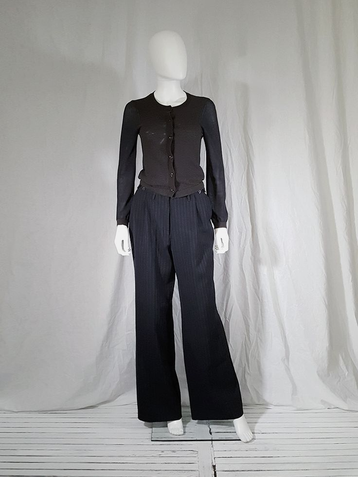 Dries Van Noten dark blue pinstripe trousers with pleated waist. Shop for curated vintage designer clothing and second hand runway garments at Vaniitas.