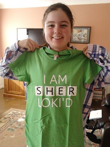 My daughter, Kathleen, with the t-shirt she designed.    http://www.redbubble.com/people/keyverse/works/11958076-i-am-sherlokid