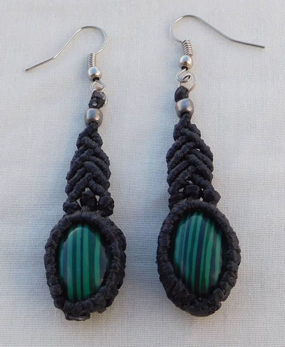 Classic shaped black earrings with malachite cabochons.These earrings can add a special touch on your total black outfit or can be combined with a green tone to tone outfit.Be the first to have them, and take advantage of their special price!  -Length 5.5 cm -Cabochon width 1.5 cm  Faux silver hooks