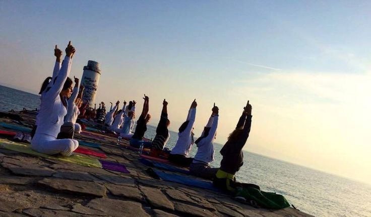 Group yoga in Oia village, Santorini island, Greece. - www.oiamansion.com