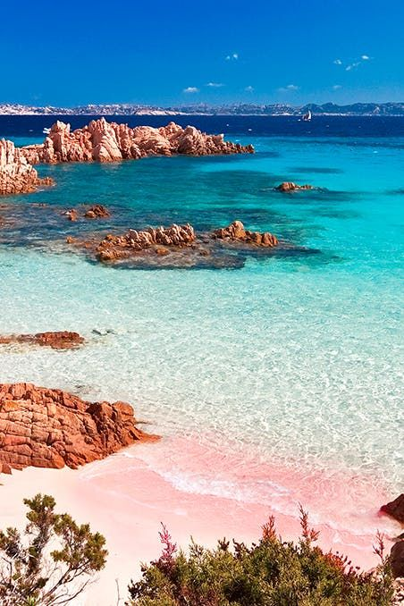 The 9 Most Beautiful Pink Sand Beaches in the World #purewow #travel #beach #vacation inspiration #international