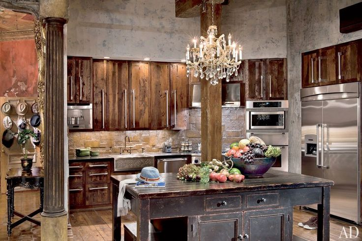 """Repurposed flooring in Gerard Butler's NYC Loft: """"The kitchen's cabinetry and backsplash were fashioned from leftover flooring materials."""""""