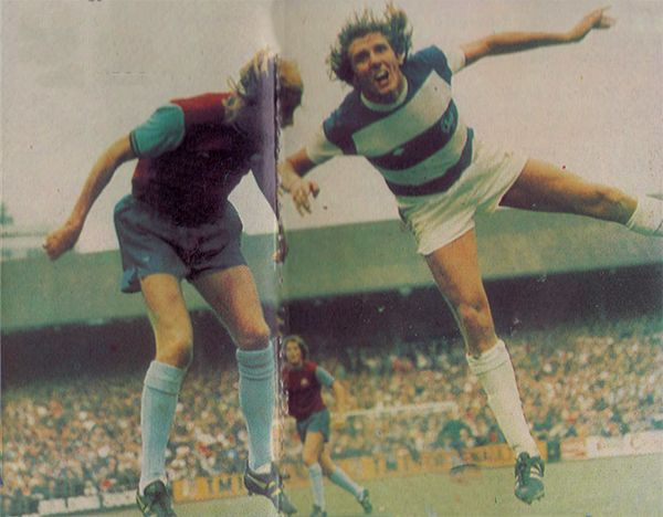 30th August 1975. West Ham United centre forward Alan Taylor jumping with Queens Park Rangers defender Ron Abbott, at Loftus Road.