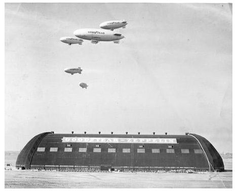 Goodyear Air Dock, Akron Ohio. I remember seeing three blimps in the skies, but never five. This must have been during the war.