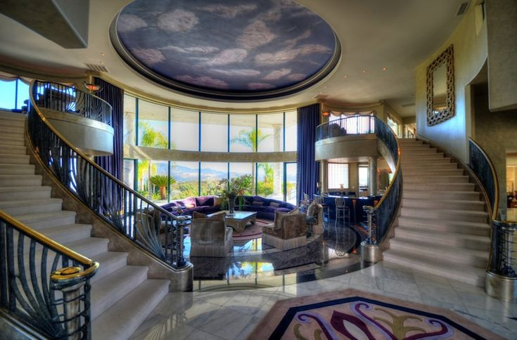 The 38 foot diameter rotunda is flanked by two massive curved staircases. It boasts 20 foot high curved glass windows, the rare Schimmel Pegasus piano, wet bar, fibre optic starlit mural on the ceiling, and views of Folsom Lake and pristine landscaping. -Granite Bay Mountaintop Estate – $12,000,000 Previously Owned By Eddie Murphy.