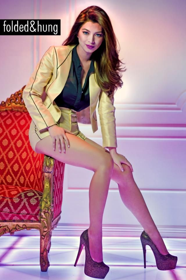 "Kapamilya leading lady Angel Locsin is looking glamorous for her comeback as Folded & Hung's main endorser for its Holiday campaign. In a post announcing her ""return"" to the lifestyle brand's Facebook page, Locsin is seen posing in matching gold shorts and blazer over a see-through button-down."